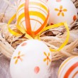 Decorative Easter eggs, on a rustic wooden table — Stock Photo