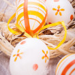Decorative Easter eggs, on a rustic wooden table — Stock Photo #39104429