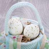Three natural blue Easter eggs in a basket — Stock Photo