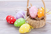 colorful easter egg decoration on wooden background — Stockfoto