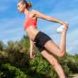 Young attractive athletic woman stretching fitness — Stock Photo