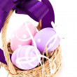 Straw basket with traditional Easter eggs — Stock Photo #40761333