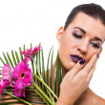 Beautiful woman in purple make-up — Stock Photo #40762087