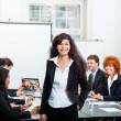 Professional successful business woman in office smiling — Stock fotografie