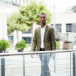 Stock Photo: Young successful africbusiness moutdoor in summer