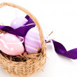 Straw basket with traditional Easter eggs — Stock Photo #40763207