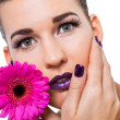 Beautiful woman in purple make-up — Stock Photo