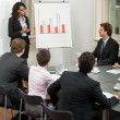 Stock Photo: Business people team in office presentation plan