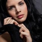 Dark moody portrait of a brunette beauty — Stock Photo