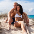 Affectionate young couple on the beach — Foto Stock