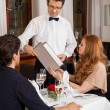 Waiter serving a couple in a restaurant — Stock Photo #40764301