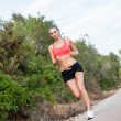 Stock Photo: Young athletic womrunner jogger outdoor