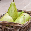Fresh ripe pears in a wicker basket — Stock Photo