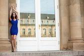 Beautiful brunette woman in blue dress outdoor — Stock Photo