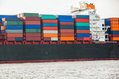 Fully laden container ship in port — Stockfoto
