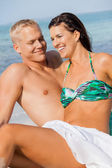 Happy young couple sunbathing — Stock Photo