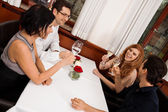 Happy friends in restaurant — Stock Photo