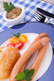 Tasty sausages frankfurter with grain bread — Stock Photo