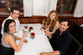 Smiling happy people friends in restaurant — Stock Photo