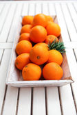 Fresh orange fruits decorative on table in summer — Foto Stock