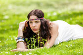 Pretty young woman in a headband daydreaming — Stock Photo