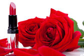 Sexy red or scarlet lipstick with roses — Zdjęcie stockowe