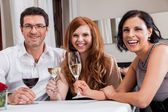 Friends in restaurant — Stock Photo
