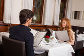 Waiter serving a couple in a restaurant — Stock Photo