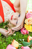 Beautiful woman portrait outdoor with colorful flowers — Stock Photo