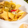 Nachos, cheese sauce — Stock Photo