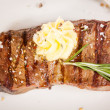 Stock Photo: Beef steak topped