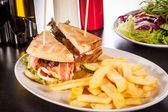 Club sandwich with potato — Stock Photo