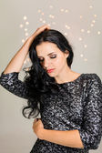 Woman with glitter dress — Stock Photo