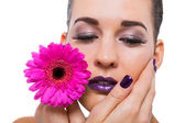 Alluring woman with flower — Stock Photo