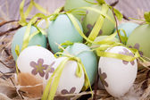 Easter eggs in straw — Stock Photo