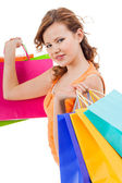 Attractive shopaholic with bags — Stock Photo