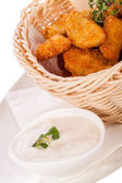 Chicken nuggets in a basket — Stock Photo