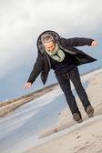 Woman frolicking on beach — Stock Photo
