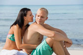Happy couple sunbathing — Stock Photo