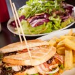 Club sandwiches with French fries — Stock Photo