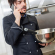 Chef taking a call on his smartphone — Stock Photo #43218485