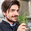 Chef checking the freshness of a bunch of herbs — Stock Photo