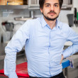 Friendly attractive man in a commercial kitchen — Stock Photo