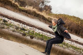 Happy senior woman frolicking on the beach — Stock Photo