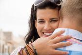 Happy woman hugging her boyfriend — Stock Photo