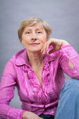 Friendly blond trendy senior lady — Stock Photo