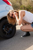 Woman talking with breakdown service — Stock Photo