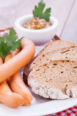Sausages frankfurter with grain bread — Stock Photo
