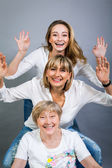 Striking family  with arms raised — Stock Photo