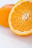 Fresh orange halved to show the pulp — Stock Photo